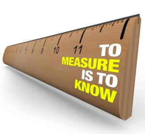 A wooden ruler with the words To Measure is to Know, symbolizing the importance of gathering information when attempting to learn the nature of an object or issue