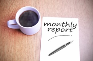 Black coffee on the table with note writing monthly report
